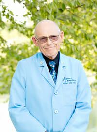 Dr. William L. Coker